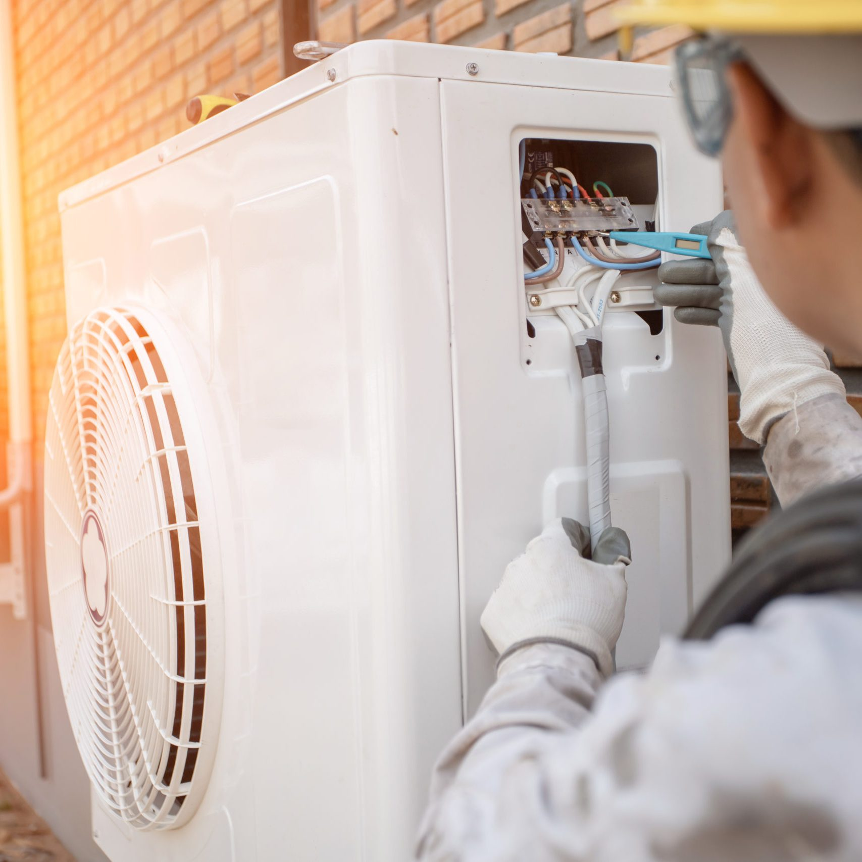 Air Conditioning Technician and A part of preparing to install new air conditioner. Technician vacuum pump evacuates and checking new air conditioner